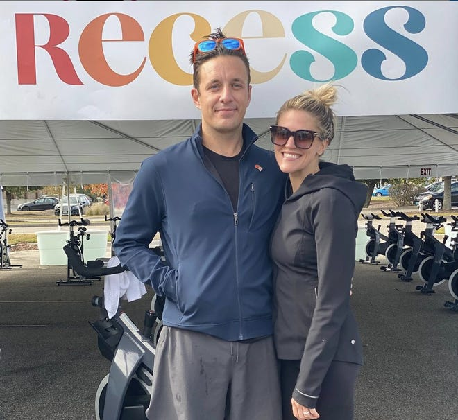 """One Tree Hill"" alum Bevin Prince (right), with her husband Will, on the opening day of Recess by Bevin Prince, a new open-air cycling studio at Mayfaire Town Center."