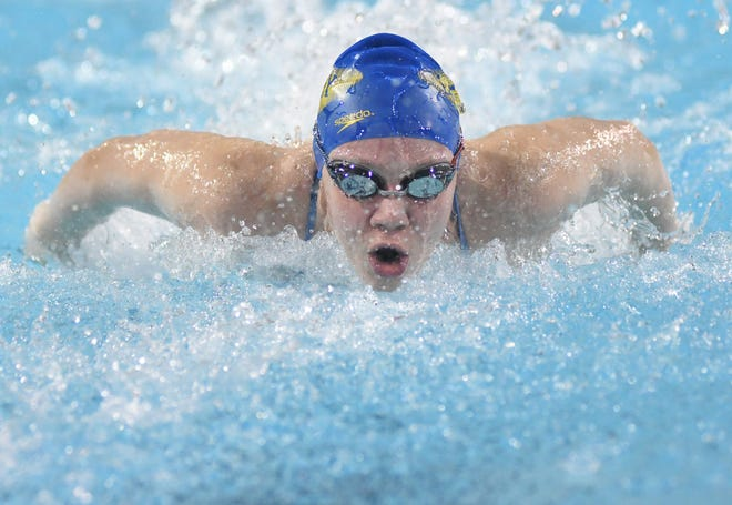 Laney's Jenna Grill swims the 100-yard butterfly during the Mideastern Conference swimming championships at UNCW on Friday, January 24, 2020.