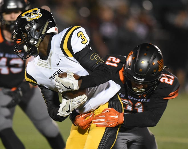 Topsail's Johnathan Ward runs against New Hanover in the first round of the 3A football playoffs at Legion Stadium in Wilmington, N.C., Friday, November 16, 2018.