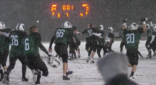 Wachusett players rush the field as time expires in their 34-0 win over Holy Name in the Division 1 Super Bowl in 2009.