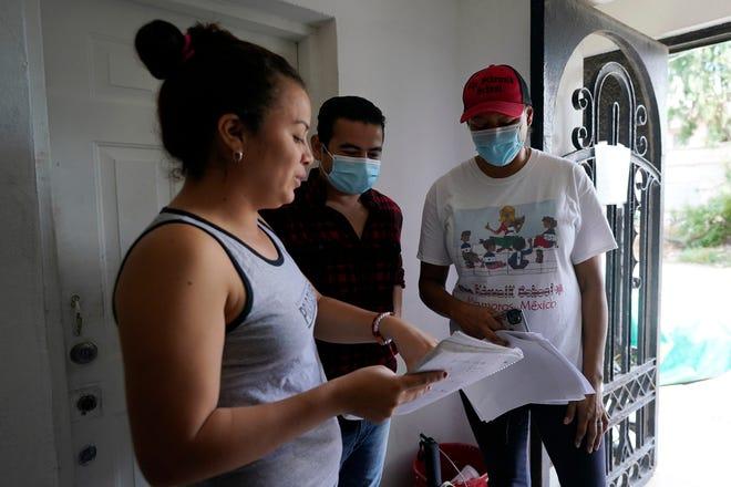 Sidewalk School founder Felicia Rangel-Samponaro, right, works with teacher Gabriela Fajardo, a 26-year-old Honduran seeking asylum in the United States, left, and assistant Victor Cavazos on Nov. 20 in Matamoros, Mexico.