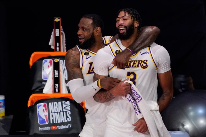 Anthony Davis, right, is finalizing a five-year contract worth up to $190 million to return to the Los Angeles Lakers.