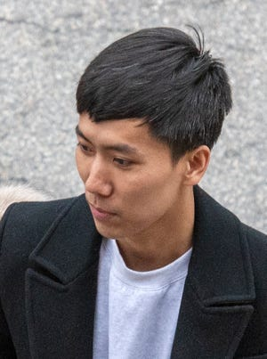 WORCESTER - Former Beth Israel researcher Zaosong Zheng leaves federal court in Worcester Friday, March 6, 2020. [T&G Staff/Rick Cinclair]