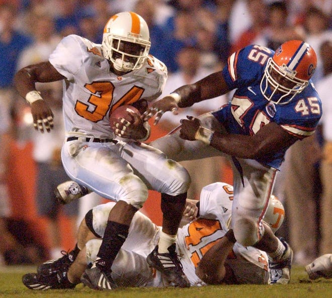 Florida linebacker Andra Davis (45) attempts to tackle Tennessee running back Travis Stephens (34) during the 2001 game at Florida Field. The Vols won 34-32.