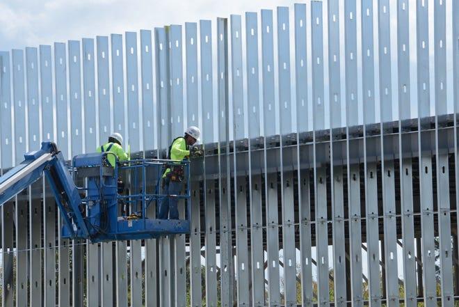Construction crews work in Butler Plaza in Gainesville in 2017.