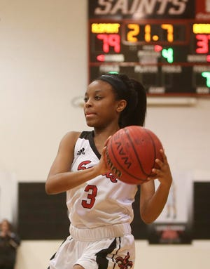 Holy Spirit's Ziona Pruitt (3)), shown in a 2018 game, scored 20 points in  the Saints' 35-32 win at American Christian Academy on Thursday night.
