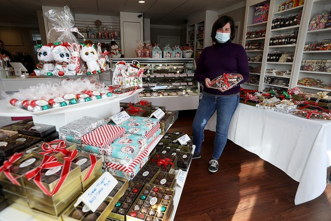 Marie Malmin of The Peppermint Twist holds a holiday gift platter that you can find in her store in Library Plaza on Thursday, Dec. 3, 2020.