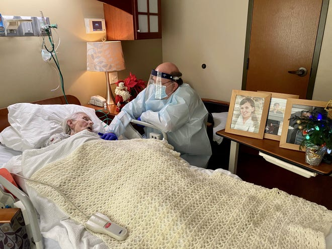 "Tom Mobley, of Fairfield, sits on Dec. 4, 2020 with his mother, Marjorie Mobley, who is in Hospice of Dayton. She has COVID-19 and is not expected to live, he said. 'She can't die in vain,"" said Tom Mobley, a University of Cincinnati professor."