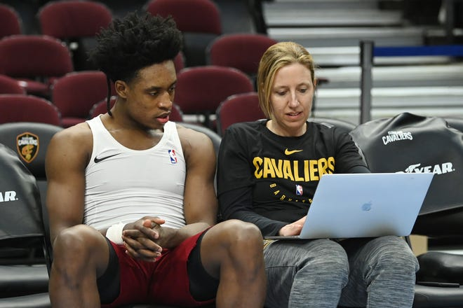 Cavaliers guard Collin Sexton (2) works with assistant coach Lindsay Gottlieb before a game earlier this season. [USA TODAY Network]