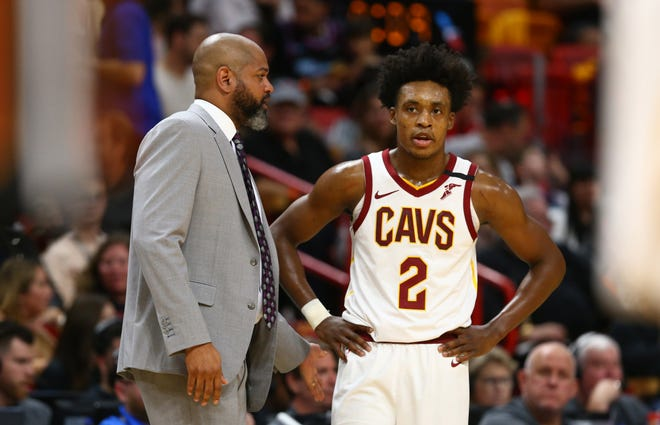Cavaliers coach J.B. Bickerstaff and guard Collin Sexton (2) talk during a game last season. Holding the team accountable for their efforts and taking that type of criticism will be key for the Cavs this season. [Associated Press]