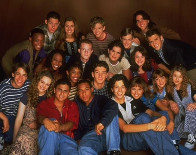 The All-New Mickey Mouse Club cast photo, from left: T.J. Fantini, Tate Lynch, Jennifer McGill, Marc Worden, NIta Booth, Ricky Luna, Ilana Miller, Rhona Bennett, Dale Godboldo, Chase Hampton, Justin Timberlake, JC Chasez, Tiffini Hale, Matt Morris, Ryan Gosling, Nikki DeLoach, Lindsey Alley, Josh Ackerman, Tony Lucca, Brittany Spears, Christina Aguilera.