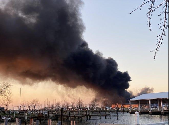 Black smoke rises from the Toledo Beach Marina Dec. 4, 2020.