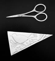 Small scissors are needed for this snowflake design.