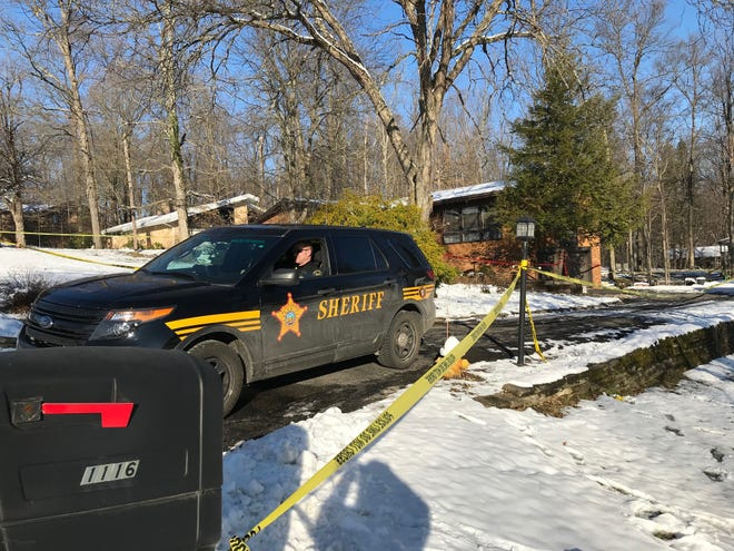 Richland County Sheriff's Deputy John VanHouten secures the site at 1116 Lexwood Road Friday morning. A Richland County Sheriff's deputy was wounded and a shooting suspect died Thursday following an exchange of gunfire inside the house, officials said.