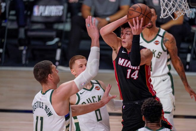 Whitnall  graduate Tyler Herro and the Miami Heat, who knocked the Bucks out of the playoffs this summer, are scheduled to host the teams' first two meetings of the coming season on Dec. 29 and 30.