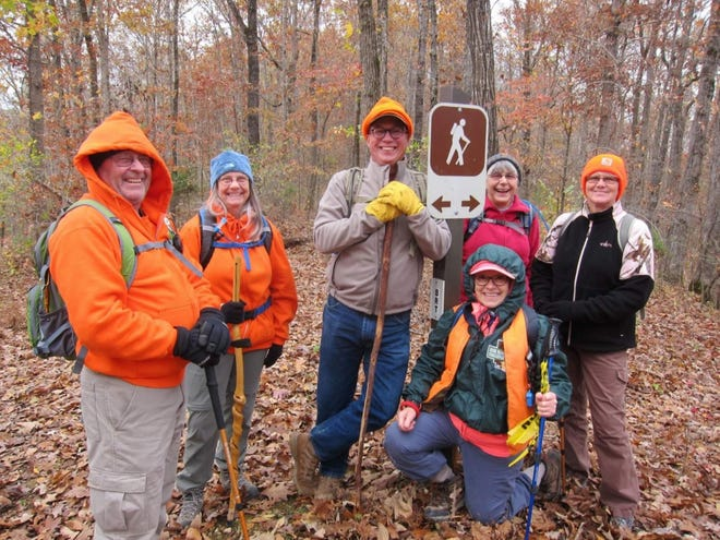 Members of the North Central Arkansas Master Naturalists take a break during a hike along the Buffalo River Trail during a 2019 hike. Members shown above are, from left, Mike Rees of Lakeview, Dottie Bauer of Flippin, Gordon King of Norfork, Tricia Turner of Mountain Home, Liz Harris of Mountain View and Debbie Rees of Lakeview.