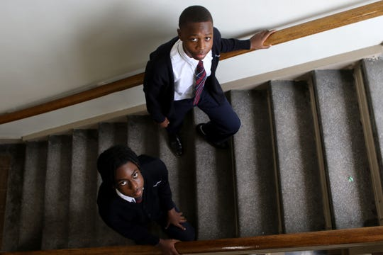 Samwel Onserio (open sweater) and Joshua Etienne were both getting onto the stairwell after recess when shots began to ring out December 10, 2019.  Today, they still attend Sacred Heart School and are in the eight grade. Wednesday, December 2, 2020
