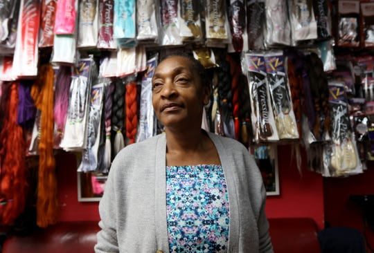 Pauline Ndzie is the co-owner of Sophie Best African Hair Braiding, located two doors down from where the shooting occurred. Ndzie said her business has been crippled by the incident and COVID-19.  She says she has emotional scars from the shooting but can not afford to see a doctor about the issue. Tuesday, December 1, 2020