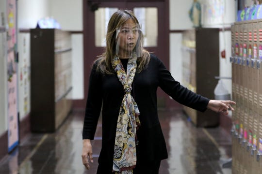 Sacred Heart School  Teacher, Amalia Ramos, speaks to NorthJersey.com as she recounts December 10, 2019 and leading her second grade students as they crawled across the hallway (shown).  Ramos wanted to make sure she got her students away from the Martin Luther King Dr. side of the school, where her classroom windows are located and where the bullets were coming from.  Multiple windows from her classroom had to be replaced due to the gun fire. Tuesday, December 1, 2020
