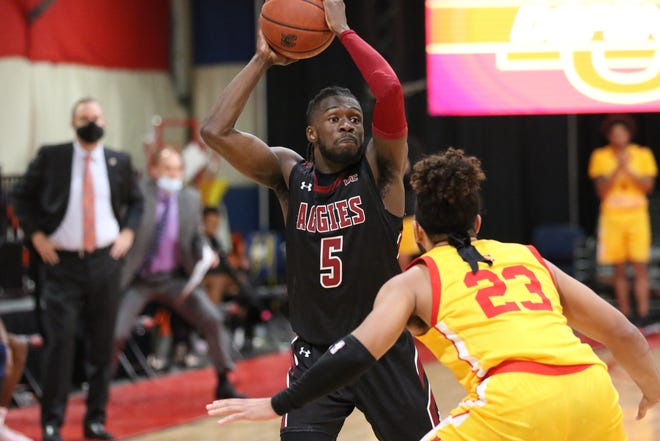 Clayton Henry looks for the open man during New Mexico State's 83-77 win over Arizona Christian on Nov. 30, 2020, in Glendale, Arizona.