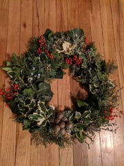 Bernalillo County Extension Agent John Garlisch made this stunning wreath using sprigs of redtwig dogwood, holly, cotoneaster, English ivy, juniper, and nandina berries.
