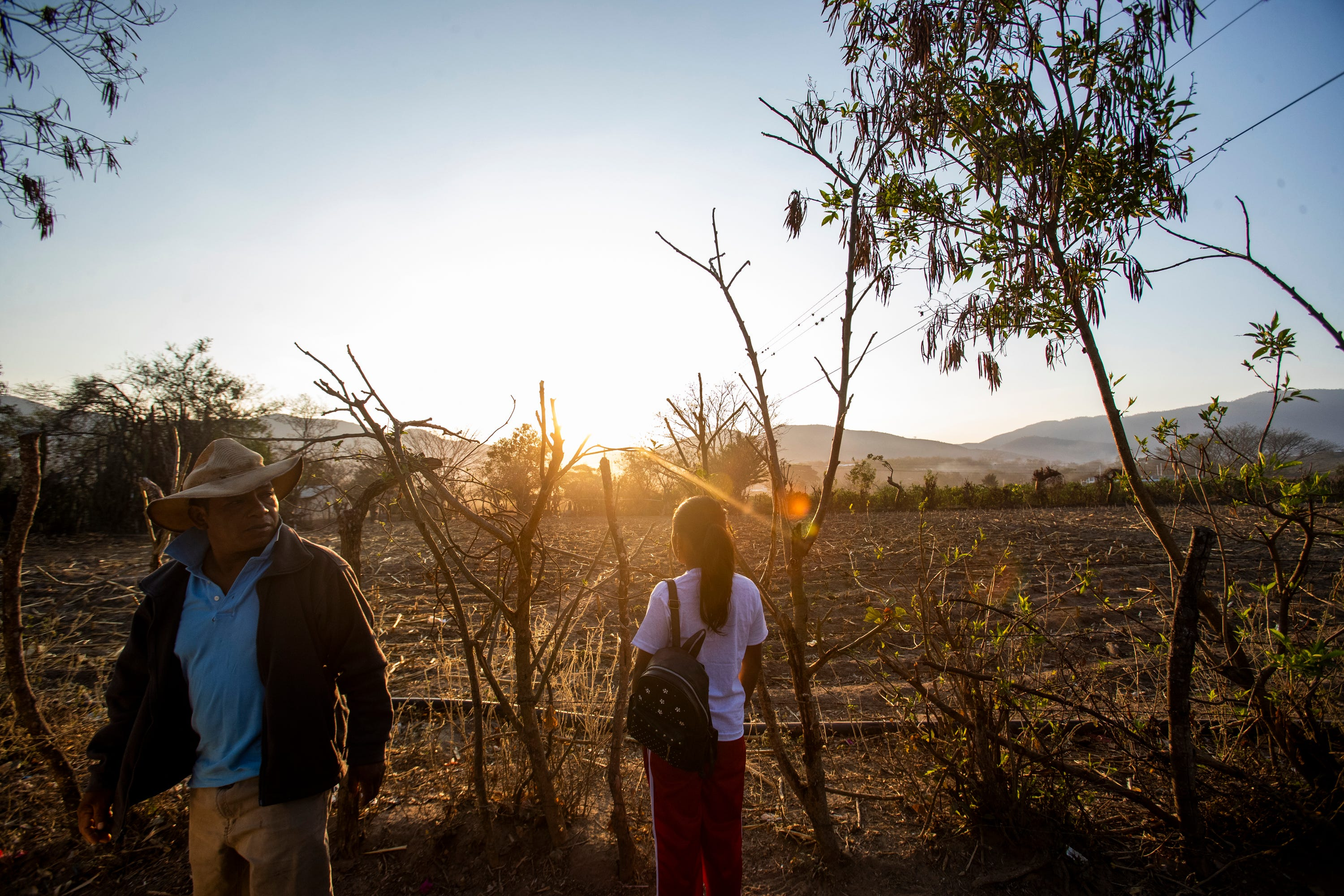 Francisco Sical gets ready to walk his daughter Melissa to school in Baja Verapaz, Guatemala, in March.