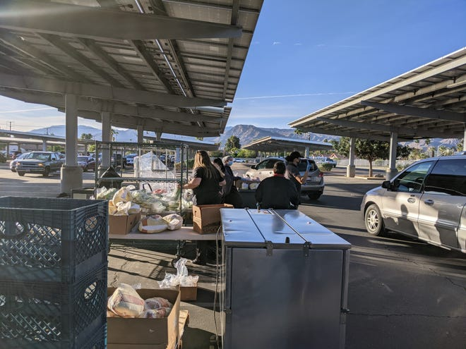 Thanksgiving meal distribution at Cathedral City High School