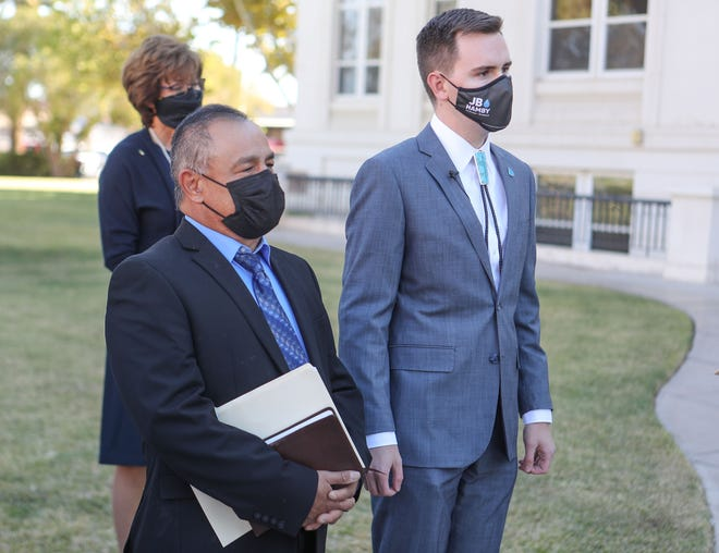 Newly elected Imperial Irrigation Board District directors Javier Gonzalez, left, and JB Hamby wait to be sworn at the Imperial County Courthouse in El Centro, December 4, 2020.