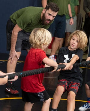 Ryan Blackwell shouts words of encouragement to a group of children training Nov. 23, 2020, at his new WELL Trained gym and fitness center. The former Navy airman was shot multiple times during the Dec. 6, 2019, terrorist attack at NAS Pensacola.