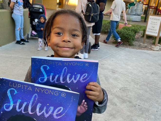 "A child at UMOM New Day Centers picked out Lupita Nyong'o's ""Sulwe,"" which tells the story of a girl with dark skin discovering her beauty."