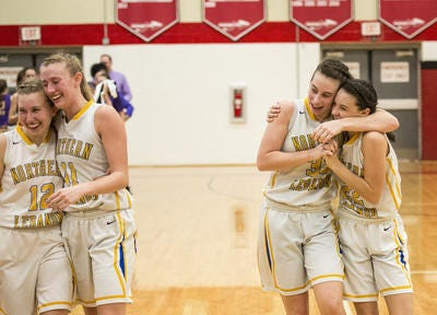 Sisters Zoe and Zara Zerman, right, embrace after a district playoff win for the Northern Lebanon girls in 2017. The two were hoping to be teammates again this season at Kutztown University, but the school recently canceled the season due to  COVID-19 concerns.