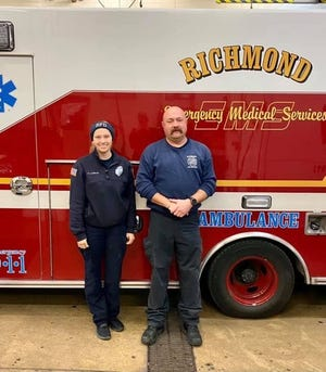 Shaina Laughlin and John Owens of Richmond Fire Department attempted to save a dog brought out of a house fire Thursday, Dec. 3, 2020.