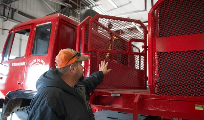 Irion County Volunteer Fire Department chief Bill Taylor points out the features of the department's new truck seen here in this Friday, Dec. 4, 2020 photo.