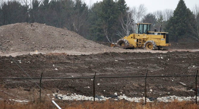 The scene near the Edgewater Power Generating plant as seen, Tuesday, November 24, 2020, in Sheboygan, Wis. The utility is working on closing and capping ponds near the plant.