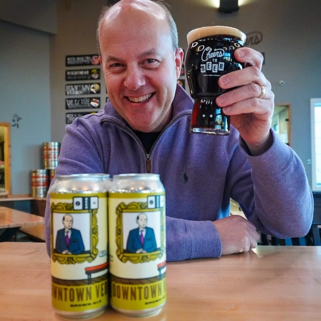 Vernon Brown poses with one of the newest canned beers at Look's Beer Co., the Downtown Vernon Brown Ale.