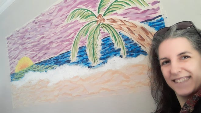 ArtBridge Tallahassee director Lisa Girard turned the walls in her home into a giant canvas, creating her own beach scene.