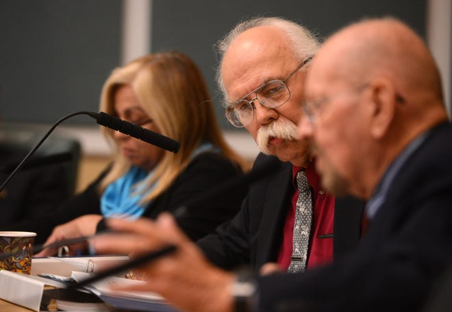 Jon Sharkey, center, listens to fellow City Council member Jim Hensley during a November 2015 Port Hueneme City Council meeting. Sharkey died from brain cancer Tuesday, Dec. 1, 2020.