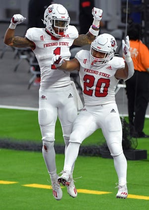 Nov 7, 2020; Paradise, Nevada, USA; Fresno State Bulldogs wide receiver Keric Wheatfall (1) celebrates with running back Ronnie Rivers (20) after Rivers scored a touchdown against the UNLV Rebels during the second half at Allegiant Stadium. Mandatory Credit: Stephen R. Sylvanie-USA TODAY Sports