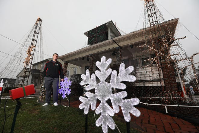 Austin Lemmon and his brother Brandon have programmed a light show at their Lindbergh Avenue home in Zanesville for the fourth year.