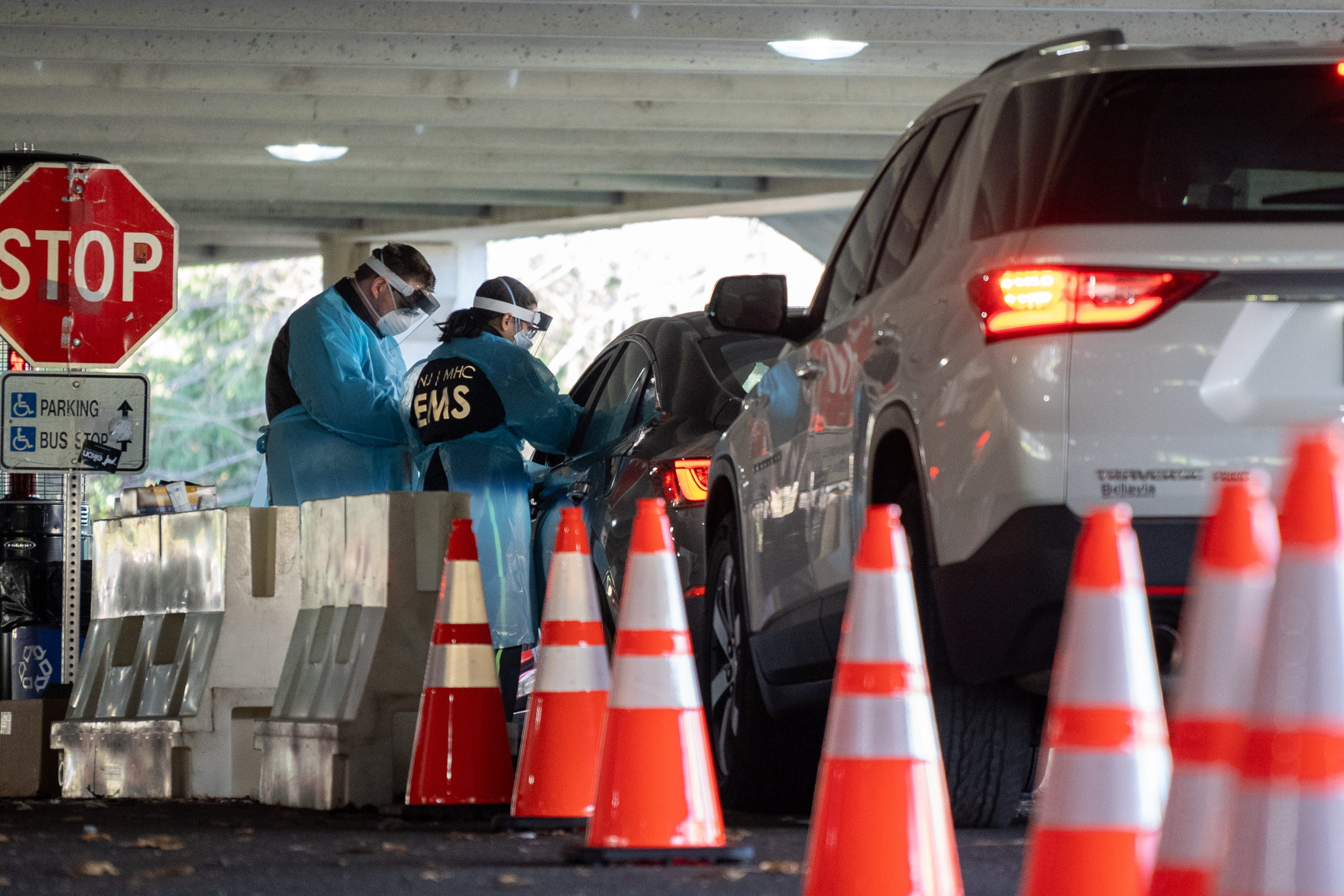 People come to be tested Dec. 3 for COVID-19 at a county-run test site in a parking lot at Bergen Community College in Paramus, New Jersey. The state is on track to hit a coronavirus milestone by the end of the year with 1 in 500 residents dead due to the virus.