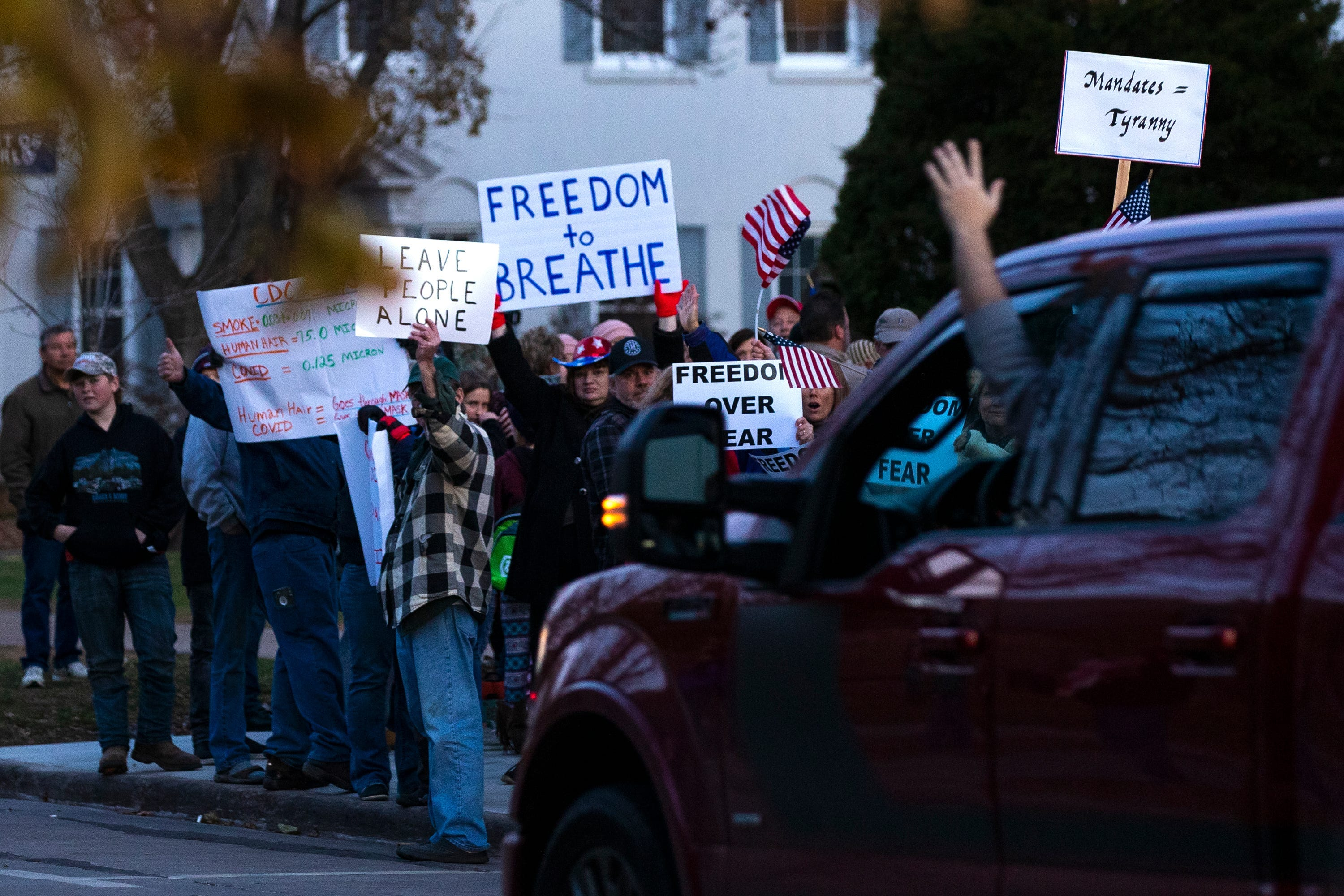 Community members protest proposed mask order Monday, Nov. 2, 2020, at City Hall in Wausau, Wis.