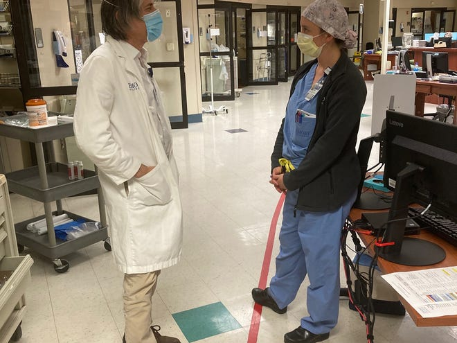 Joel Zivot, an Emory University professor and ICU doctor, speaks with Hailey Wetta, a critical care physician. Both work with COVID-19 patients at Atlanta's Emory Decatur Hospital.