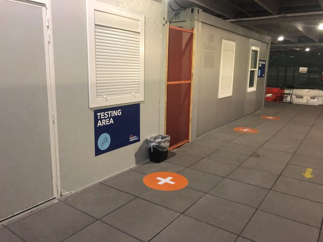 LaGuardia Airport in New York offers free COVID-19 testing in modular offices in a parking garage in Terminal B. Travelers visit three windows, with the test conducted at the last one.
