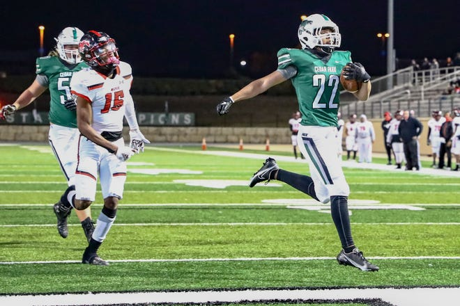 Gavin Mundell leaps into the end zone for Cedar Park during the Timberwolves' 59-18 win over Manor Friday at Gupton Stadium. Mundell finished with 25 yards on three totes.
