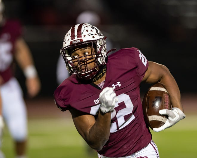 Round Rock's Israel Morgan takes off for a run against Westwood in the Dragons' 70-41 win Friday at Dragon Stadium. Morgan set a new school record with 458 yards rushing to help Round Rock clinch a share of the District 25-6A title as well as the top Division I playoff seed.