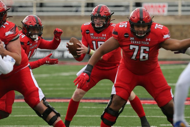 Texas Tech Red Raiders quarterback Alan Bowman (10) takes a snap from center in the first half in the game against the Kansas Jayhawks on Saturday at Jones AT&T Stadium in Lubbock.
