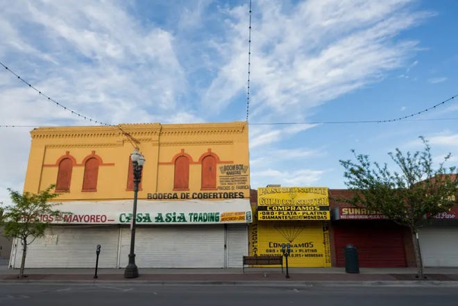 Storefronts in downtown El Paso are shuttered during the coronavirus pandemic.