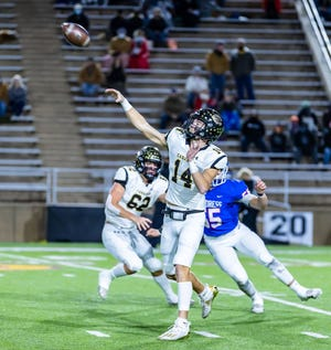 Canadian senior quarterback Josh Culwell launches the ball  during Friday's 45-14 win over Childress in the Class 3A Division II Quarterfinals at Happy State Bank Stadium.
