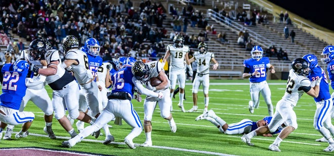 Canadian senior running back Hayze Hufstedler attempts to get through Childress' junior linebacker Collin Bishop for more yardage during Canadian's 45-14 win over Childress in the Class 3A Division II Quarterfinals Friday evening at Happy State Bank Stadium.