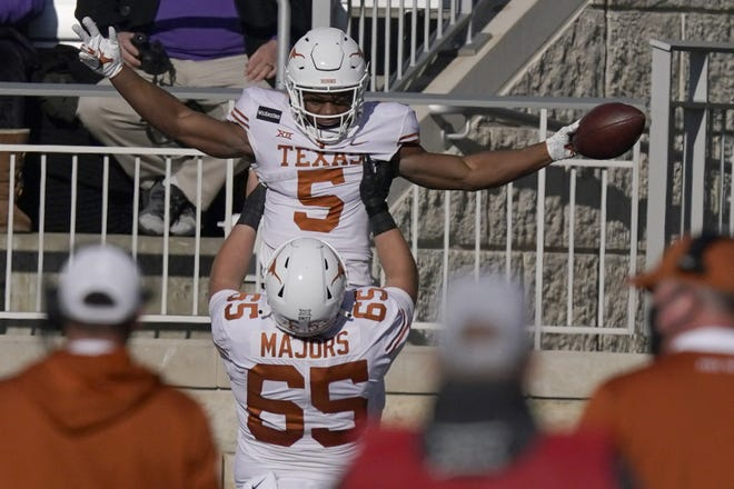 Texas running back Bijan Robinson celebrates a touchdown scored against Kansas State with teammate Jake Majors during last season's game in Manhattan. Robinson figures to be a key part to first-year coach Steve Sarkisian's offense.